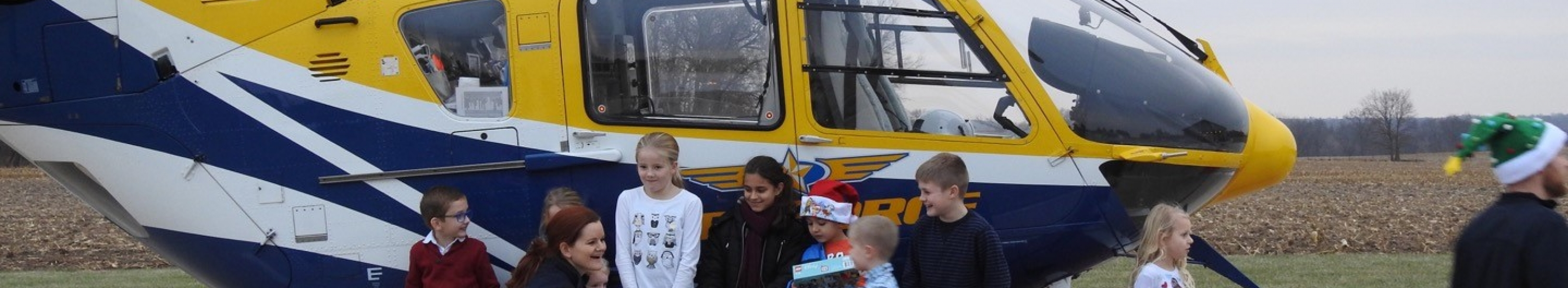 children in front of medforce aircraft